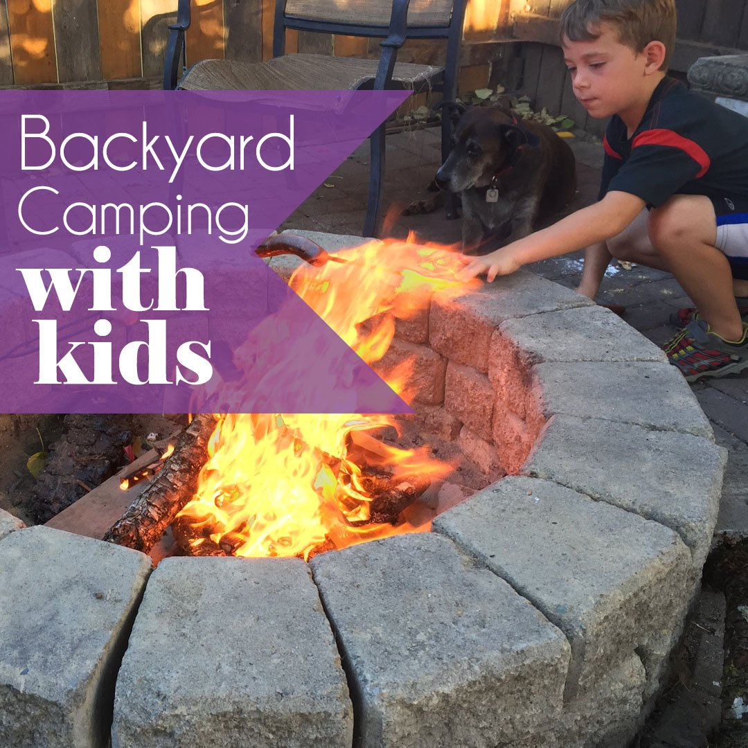 Roasting marshmallows while backyard camping with the kids
