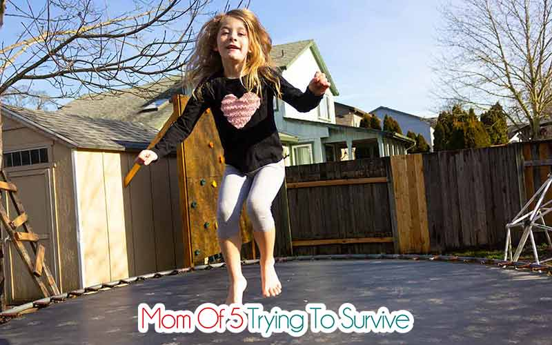 child jumping on trampoline with reverse applique shirt on