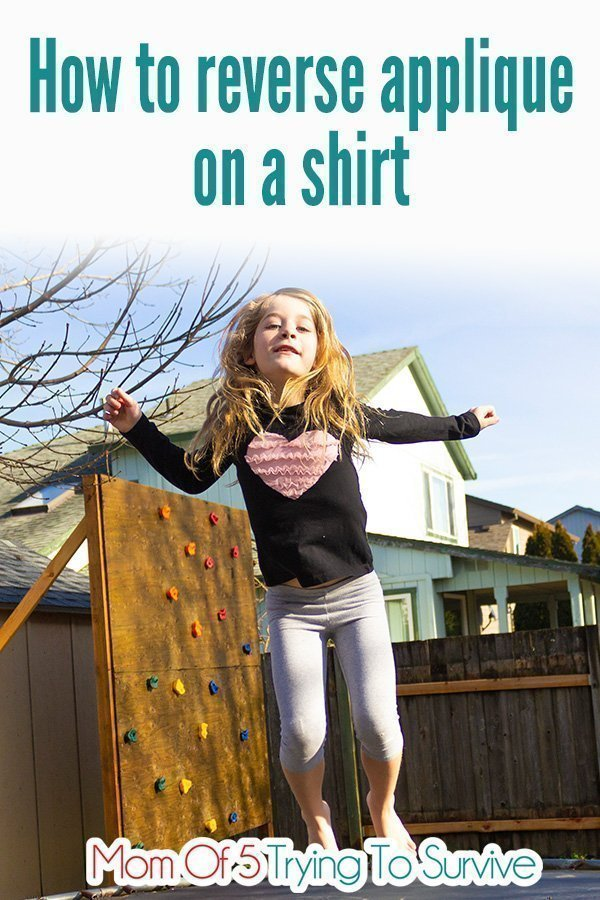 girl jumping on trampoline while wearing reverse applique heart shirt