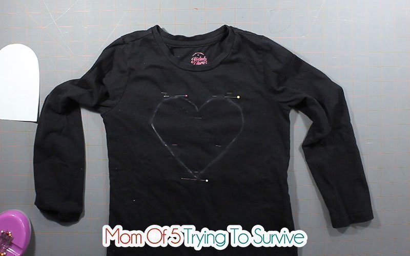 traced heart on black shirt