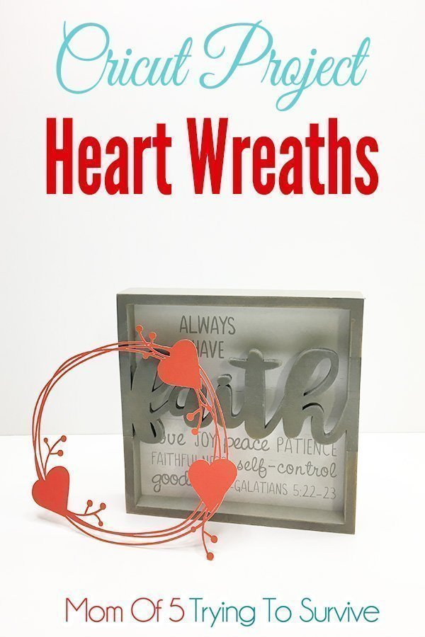 paper heart wreath displayed with a wood quote
