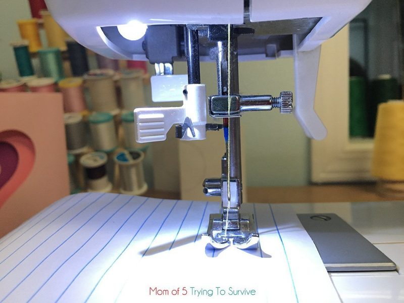place paper under sewing foot before unscrewing needle