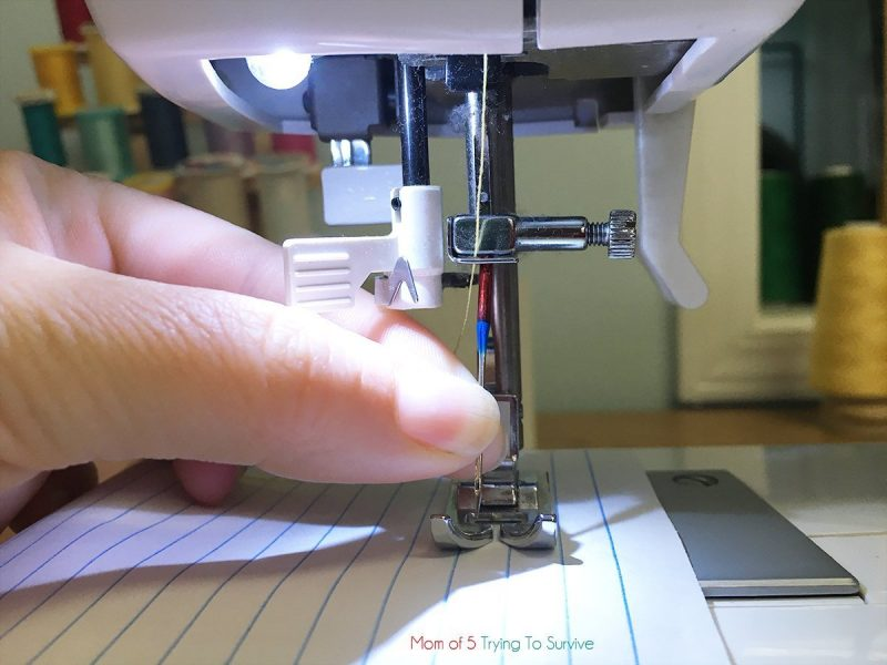 place new needle in sewing machine