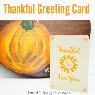 Thankful for you card next to a pumpkin painting